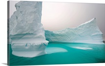 Iceberg with steep walls and patterns created by melting and waves