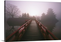 Japanese footbridge and temple in the mist, Honshu Island, Japan