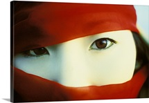 Korean eyes peer our behind a scarf