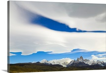 Lenticular and cumulus clouds in blue sky above Fitzroy Massif