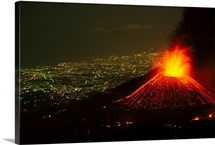 Lights of Catania are outstretched beneath an erupting Piano del Lago