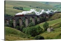 Locomotive crosses the Dent Head Viaduct, North Yorkshire, England