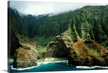 Mist rises above cliffs and overgrown gorges, Hawaiian Islands