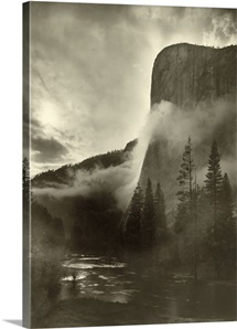 Mist rises as El Capitan towers 3,600 feet above the Merced River
