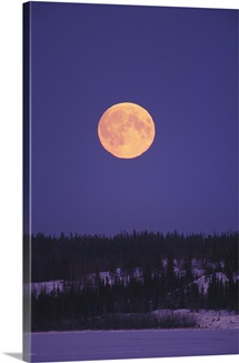Moonrise over a lake in the winter, Northwest Territories, Canada