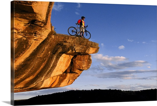 Mountain biker takes in view of Colorado, Dolores, Colorado