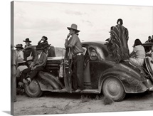Native American Indians atop a car in New Mexico