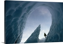 NGS author Fred Kline climbs around the entrance of an ice cave