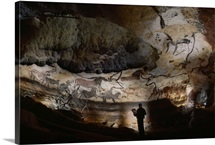 Paleolithic bulls and other painted animals crowd calcite walls in Lascaux Cave