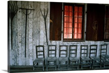 Porch of the Bolduc House Museum with antique chairs and rakes, Missouri