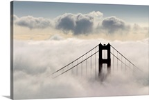 San Francisco's Golden Gate Bridge surrounded by clouds and fog, California
