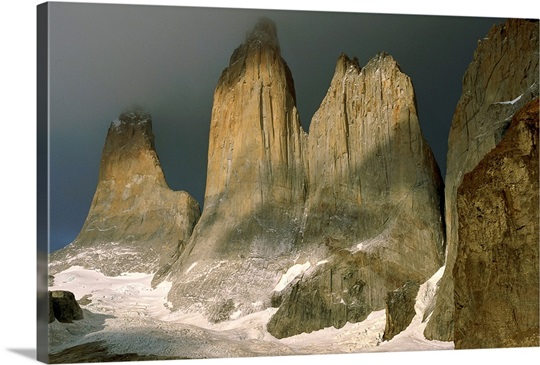 Sharp, towering mountain peaks pierce the heavens in Torres del Paine, Chile