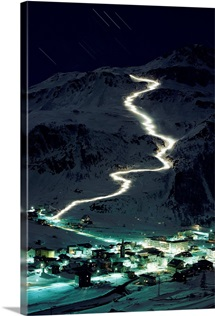 Skiers bearing torches ski down Mont Blanc glaciers to Val d'Isere, France