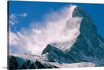 Snow blows off of the Matterhorn above Zermatt, Switzerland