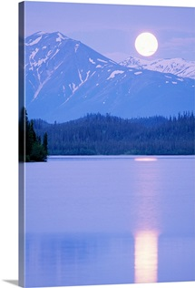 Solstice full moon rising over Silver Lake, Wrangell-Saint Elias National Park, Alaska
