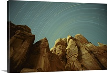 Star streaks over sandstone formations, Utah