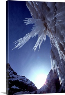 Sunlight glints on the bearded face of Gangotri Glacier high in the Himalayas, India