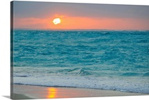 Sunset in paradise over the Caribbean and on a beach
