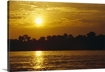 Sunset over lowland tropical rainforest along Amazon River, Amazon Basin, Brazil