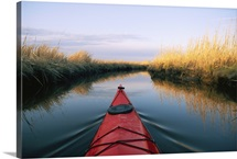 The bow of a kayak points the way in a Chesapeake Bay salt marsh