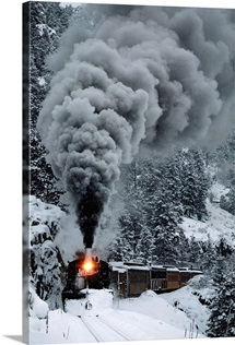 The Durango &amp;amp; Silverton Narrow Gauge Railroad train chugs through the snow, San Juan Mountains, Colorado