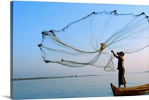 The head fisherman casts his net