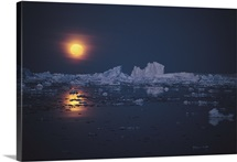 The moon reflecting on ice-choked water, Antarctica