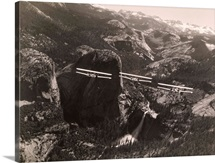 Three airplanes fly over Liberty Cap in Yosemite