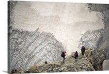 Three mountaineers descending to a glacier