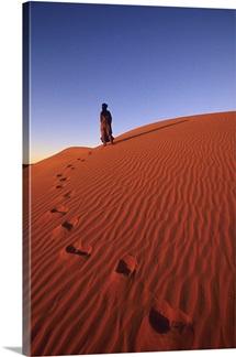 Tuareg guide Yahya standing on a sand dune
