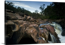Waterfalls have carved holes in the bedrock, Murray River, Western Australia