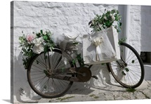 Bicycle parked against a wall, Trulli House, Alberobello, Apulia, Italy