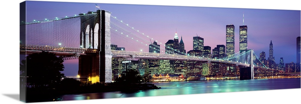 Bridge across a river lit up at dusk, Brooklyn Bridge, East River, World Trade Center, Wall Street, Manhattan, New York City, New York State