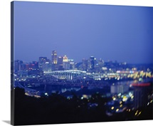 Buildings in a city lit up at dusk, Cincinnati, Hamilton, Ohio