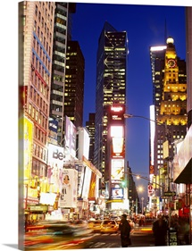 Buildings in a city lit up at dusk, Times Square, Manhattan, New York City, New York State