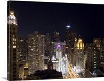 Buildings in a city lit up at night, Magnificent Mile, Upper Michigan Avenue, Michigan Avenue, Chicago, Illinois,