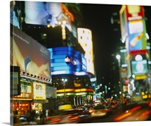 Buildings lit up at night in a city, Times Square, Manhattan, New York City, New York State