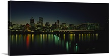 Buildings lit up at night, Willamette River, Portland, Oregon