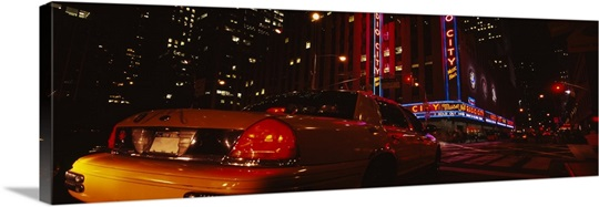 Car on a road, Radio City Music Hall, Rockefeller Center, Manhattan, New York City, New York State