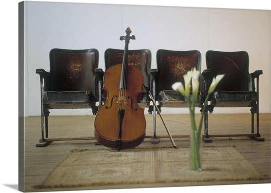 Cello leaning on attached chairs