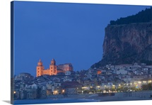 City lit up at dusk, Cefalu, Sicily, Italy