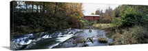 Covered bridge across a river, Northfield Falls, Vermont