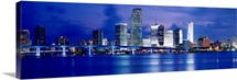 Florida, Miami, Panoramic view of an urban skyline at night