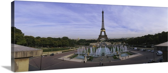 Fountain in front of a tower, Eiffel Tower, Paris, France