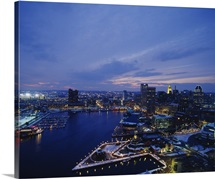 High angle view of a city lit up at dusk, Baltimore, Maryland