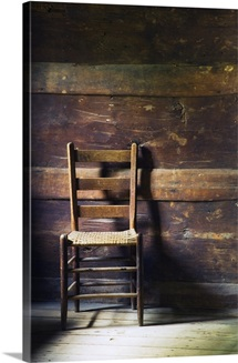 Ladderback chair in empty room, Mountain Farm Museum, Great Smoky Mountains National Park, North Carolina