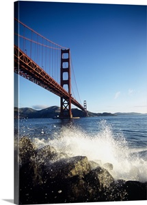 Low angle view of a bridge across the sea, Golden Gate Bridge, San Francisco, California