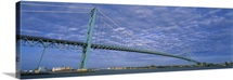 Low angle view of a suspension bridge over the river, Ambassador Bridge, Detroit River, Detroit, Michigan