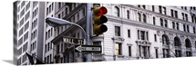 Low angle view of a traffic light in front of a building, Wall Street, New York City, New York State