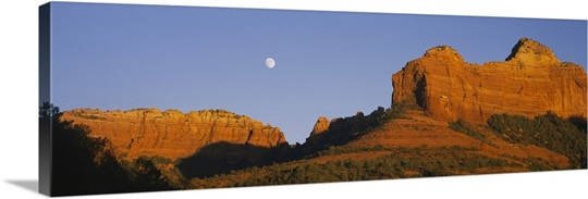 Low angle view of Moon over red rocks, Sedona, Arizona